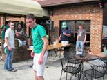 Here some guests enjoy good friends, cold drinks and a competitive game of corn hole.